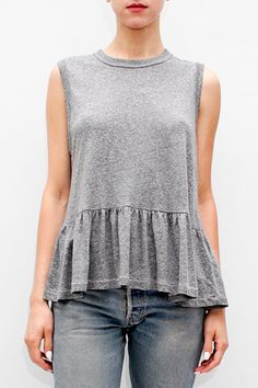 - 100% Cotton - Banded crew neckline - Distressed edges - Pleated peplum detail - Model is 5'9'' and wears a size T0.