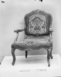 This chair clearly illustrates the strong influence of French Rococo furniture current in Venice at the time. Armchair (part of a set)  Date:mid-18th century Culture:Italian, Venice Medium:Walnut, painted and silvered; wool petit point embroidery
