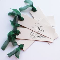 """Calligraphy place cards with green silk ribbon. A simple and with effect detail. #placecards #nametags """"#calligraphy #wedding #weddingplacecards Wedding Place Cards, Green Silk, Wedding Stationary, Silk Ribbon, Wedding Designs, Gift Wrapping, Calligraphy, Detail, Simple"""