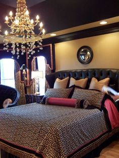 Dramatic black and gold master bedroom, This room is not for the faint of heart...Dramatic black velvet cornices...large black leather tufte...: