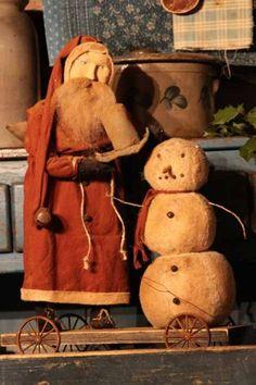 Arnett Santa putting the finishing touches on the snowman!!! www.arnettscountrystore.com