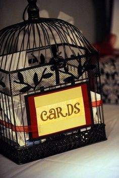 I would go for a cream colored bird cage, but this is a great idea :)