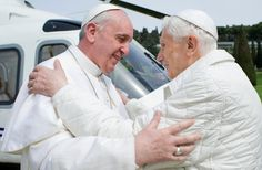 Historic meeting Between Two men with very different styles and first photo of two popes. (AFP)