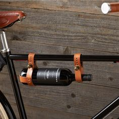 Bicycle Leather Wine Holder | LOL!  If any of us rode a bike on a regular basis, this would be useful.