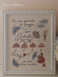 Stitch Count: 139 x 174 A soft and ironic with pastel colour with the inscription In una giornata di pioggia, apri lombrello, se non tira vento On request it is possible to buy the pattern in PDF format, you will be immediately refunded shipping costs