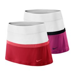 40a3a96739 Stylize your game with color block Nike Women s Court Tennis Skort!  Built-in shorts offer a supportive fit