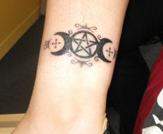 The three moons and the pentagram signifying deep belief in the inner instincts and sixth sense controlled by celestial elements.