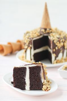 drumstick chocOlate cake with vanilla frosting, chocolate shell and chopped nuts