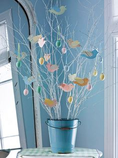 Tabletop Easter Tree ~ A simple Easter tree is made even cuter when it's propped inside a blue pail. Gather branches and spray-paint white; after drying, place inside a pail and arrange branches to stay put with foam. Add stones, glass pebbles, or the like to decorate and weigh down the container. Hang blown-out egg ornaments and homemade crafts on it