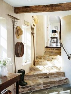 informal back entrance with flagstone steps, wood beam and unusual decorative touches such as the wall-hung wooden rake, pitchfork and sifter lMidwest Living Style Cottage, Cottage Design, Farmhouse Style, Farmhouse Decor, Farmhouse Stairs, Rustic Stairs, Rustic Cottage, Farmhouse Ideas, French Cottage Decor