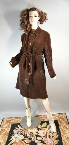 70s Brown long corduroy trench coat. Fully lined great quality vintage, no stains or holes. Matching belt. Fits like a medium or large. All measurements taken while garment is laying flat.  shoulders 18 inches  armpit to armpit 22 inches (44 around)  waist 23 inches (46 around)  nape to hem 44 inches  sleeves 24 inches | Shop this product here: http://spreesy.com/coupdetatvintage/17 | Shop all of our products at http://spreesy.com/coupdetatvintage    | Pinterest selling powered by…