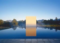James Turrell. Stone Sky. 2007. Located at Stonescape, Napa Valley. The white box pavilion has a square opening in the ceiling. To access it, one dives into the infinity pool and swims underwater.