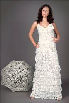 I especially love this crochet wedding dress sold on Etsy byLecrochetArt. And I adore the matching crochet umbrella!