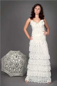 I especially love this crochet wedding dress sold on Etsy by LecrochetArt. And I adore the matching crochet umbrella!