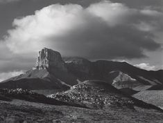 1942 El Capitan Peak, Guadalupe Mountains National Park, Texas [squared peak amid lower rounded slopes; billowing cloud] by Ansel Adams 76.89.41