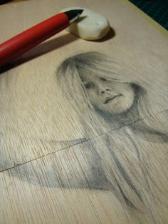 Pencil on wood
