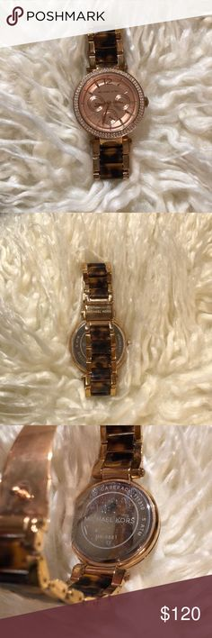 Michael Kors Parker Rose Gold & Tortoise Watch Rose gold and tortoise Michael Kors watch, slight wear on some links near clasp, but no scratches on watch head and all rhinestones are still in place. 100% authentic, watch box will be included with purchase. Michael Kors Accessories Watches