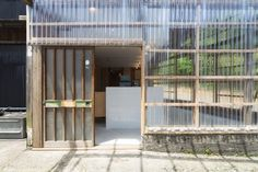 The building's original timber framework and traditional pitched roof were retained, but the walls were removed and replaced with clear sheets of ridged polycarbonate. Miyagawa Bagel by Roovice