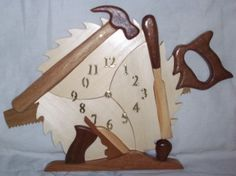A perfect addition to any shop, this Wood Tools Clock is constructed using a variety of woods resembling the actual tools, which is the intarsia method. A very nice clock for anyone who has a woodshop, men or women. Wood Crafts, Diy And Crafts, Intarsia Wood, Wood Clocks, Wood Tools, Scroll Saw, Handmade Shop, Wood Art, Woodworking Plans