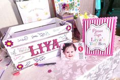 First Birthday Sign-In Toy Box. Photography by Sweet Dreams Studio.