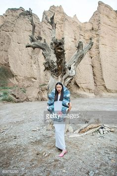 A model poses at the Yellow River Stone Forest for iconic French... #arbre: A model poses at the Yellow River Stone Forest for… #arbre