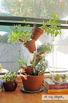 Our Cozy Cubby Hole thought up this great crooked pot idea. Use a metal rod to keep your pots in place. You could even use old wine corks as a way to tell what the plants are!