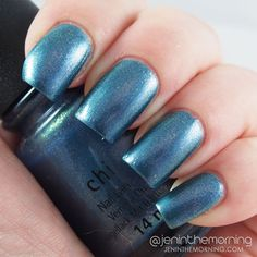 China Glaze December to Remember is a very pretty metallic blue color with gold/silver and lavender/pink micro-shimmer.