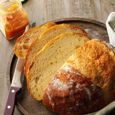 Crusty Homemade Bread Recipe -Crackling homemade bread makes an average day extraordinary. Enjoy this beautiful loaf as is, or stir in a few favorites like cheese, garlic, herbs and dried fruits. —Megumi Garcia, Milwaukee, Wisconsin