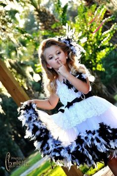 Skirt part is Three Layers of soft chiffon fabric also lined in bridal satin fabric, with soft high quality feathers  Double sided satin ribbon for the sash  Detachable brooch with matching feathers, flower and bling and cute pearls peeking out #timelesstreasure