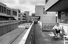 Thamesmead, Greenwich, London: a resident relaxing on his balcony. © Tony Ray-Jones / RIBA Library Photographs Collection