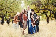 Love that dad looks like he is giving them all a big hug - great hand/arm placements. Fall family photo