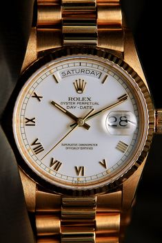Rolex Daydate with white face and SMALL PRINT ROMAN NUMERALS. ***This exact watch face but with a two tone bracelet either presidential or chainlink.