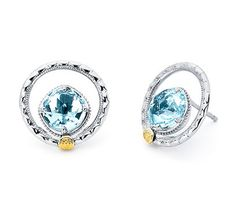 I heart these earrings from TACORI! Style no: SE14002 Stud-errific! It does not get any cleaner than this. A clear Sky Blue Topaz stone encircled by a .925 silver halo, makes for an absolutely breathtaking design. Adorned with the traditional Tacori crescents and an18k gold Tacori seal, this pair of earrings will take you anywhere you wish to go.