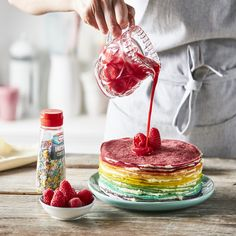 Rainbow Crepe Cake with Raspberry Coulis Recipe: This Crepe Cake may take a little time to bake up, but it's well worth the oooooohs and aaaaahs you'll get when everyone feasts their eyes on it.- One of hundreds of delicious recipes from Dr. Coulis Recipe, Pancake Day, Crepe Cake, Yummy Food, Delicious Recipes, Raspberry, Sweet Treats, Food And Drink, Sweets