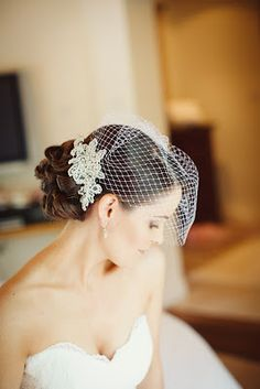 Birdcage veil with a cute clip like this. Maybe with short hair?
