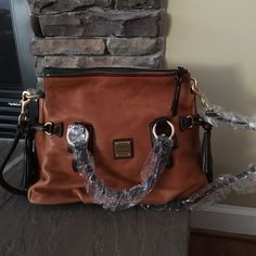 """Florentine leather Stanwich Satchel Adjustable and detachable shoulder strap, double handles side tassels four bottom feet. Two front wall slip pockets back wall zip and slip pocket key keeper approximate measurements 15.5W x 11H x 8D with a 21.5 x 24.5"""" strap drop 4.5 Handle drop Dooney & Bourke Bags Satchels"""