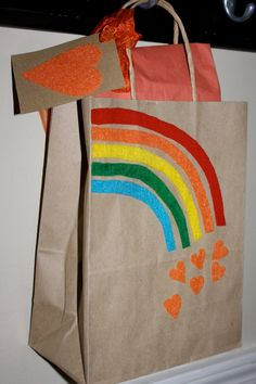 """These were the inspiration behind my party bags. Instead of handmaking the rainbow, I found a great rainbow Clip Art on the computer and set up """"Thank you for coming to my party. Love, Sydney"""" under it and printed them in color on brown paper bags."""