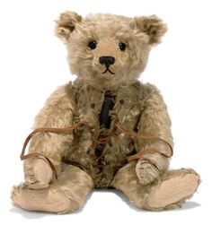 "A STEIFF TEDDY BEAR WITH HOT-WATER BOTTLE, JOINTED, BLONDE MOHAIR, BLACK BOOT BUTTON EYES, BLACK STITCHING, METAL CANISTER IN BODY, HOOKS AND LACES TO FRONT SEAM AND FF BUTTON, CIRCA 1910. 19¾"" / 50cm (Photo by Christie's.)"
