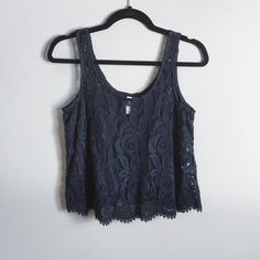 Lacey crochet black tank Super adorable black tank with Lacey crochet detailing. Slightly cropped and in great condition. ❌no trades. Xhilaration Tops Tank Tops