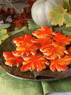 """Halloween Party Cookies - You can make Contributing Editor Larry Hayden's vibrant fall cookies by using shaped cutters, a thin sugar icing, and his techniques for dipping and """"flooding."""" Decorating instructions are explained in the accompanying recipe for Royal Icing."""