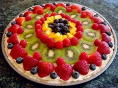 We made a dessert pizza like this using cookie dough for a crust, a whipped frosting-like topping, and covered it with fruit. Dessert Pizza, Fruit Dessert, Pizza Recipes, Cooking Recipes, Cooking Game, Delicious Desserts, Dessert Recipes, Good Food, Yummy Food