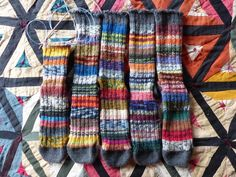 """""""Lucky Thirteen"""" scrappy yarn socks. Five nearly done, seven more to go, if the scraps hold out that far. Spent a lovely morning yesterday knitting away on that fifth one with a dear friend back in town, visiting. Oof, then I stayed up far too late last night weaving in ends while watching """"Rams."""" The quilt, it has its own story, but for another day. #scrapyarn #scrapknitting #operationsockdrawer #frankensocks #punkybrewsterkal #luckythirteensocks"""