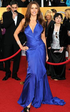 Sofia Vergara, she's funny and beautiul. What more do you need? I'm also in love the the color of this dress!