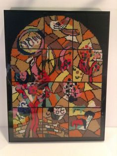 Joseph one of the twelve windows that were created by Marc Chagall for the Synagogue of the Hadassah hospital in Jerusalem, which opened on 6th February 1962. They symbolize the twelve sons of Jacob, which made the twelve tribes of Israel. - Gorgeous, professionally framed needlepoint.