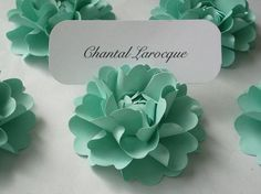 As Place Cards: These flower place cards ($150 for 50) are a unique way to seat guests at a shower or wedding.