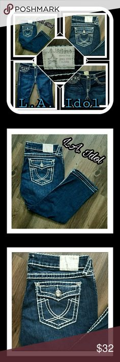 L.A. IDOL CROPPED BLUE JEANS WITH WHITE STITCHING ED HARDY.. WOMEN'S SIZE 13 (35) CROPPED BLUE JEANS WITH WHITE STITCHING. 5 POCKETS ADORNED WITH SEVERAL JEWELS. BACK POCKETS HAVE THE HORSE SHOE DESIGN WITH FLAPS. ❣❣❣MINT CONDITION❣❣❣ L.A. IDOL Jeans