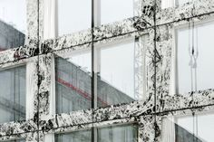 Screen printed marble pattern on a glass facade. Allianz headquarters by Wiel Arets.