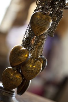 heart necklaces... made from the hearts that hung in a Paris church in memorial during WWII for soldiers.