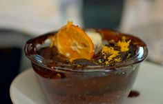 Michel Roux served up reasons to be cheerful chocolate orange puddings with cream on Hidden Restaurants. The ingredients for the sponge include: flour, dark coca powder, orange zest and juice, milk, belted butter, chocolate nuggets and water, For the sauce: water, demerara sugar and coca powder. To serve: crystallised orange and cream. The French Kitchen: 200 Recipes From the Master of French Cooking  Related PostsSimon Rimmer bread and butter pudding with Earl Grey tea recipe on Eat the...