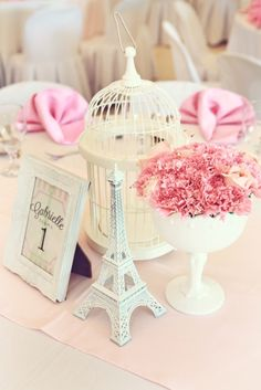 Gabrielle's Afternoon in Paris Party: Centerpiece. Find Cage and ceramic eiffel tower at FBYS.com!!! {Image via: http://partydollmanila.com/gabrielles-parisian-party/}